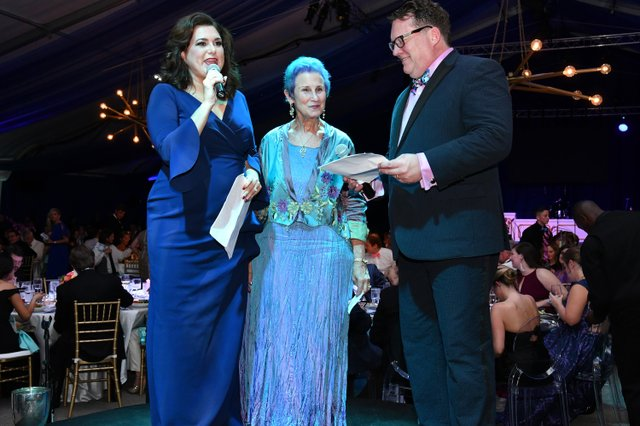 Bari Beasley and David Garrett recognize Emily Magid for her dedication to the Heritage Foundation.JPG