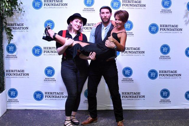 Kala Ellis and Brandon Thomason holding Joni Cole.JPG