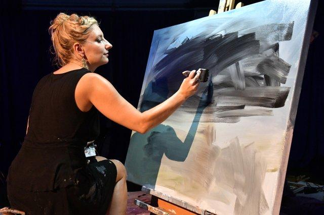 Speed painter entertains Ball guest.JPG