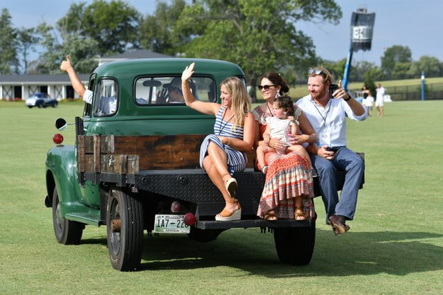 Participants in the classic car show wave to the crowd.JPG