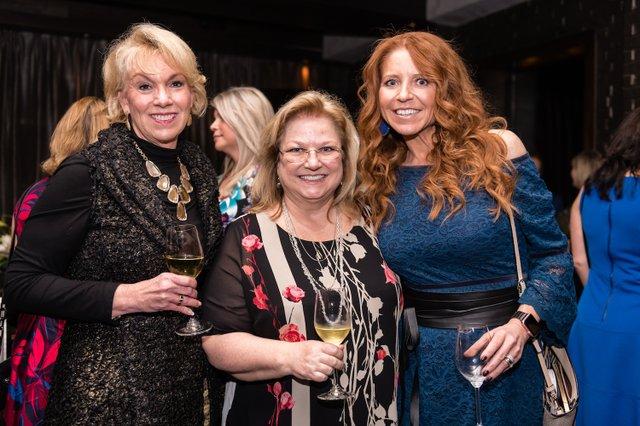 Marjorie Feltus-Hawkins, Nashville Wine Auction CEO Holly Whaley, Amy Atkinson.jpg