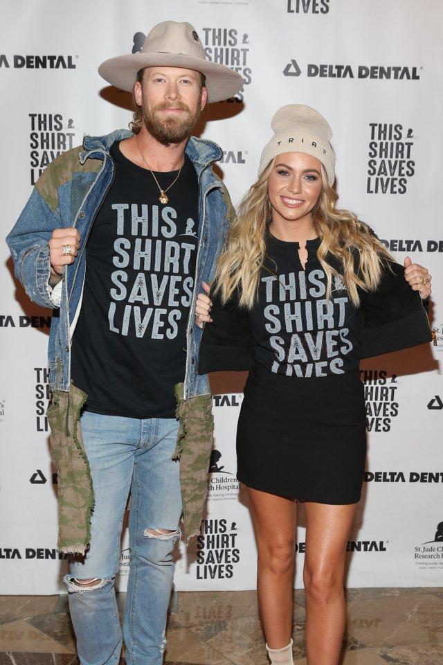 Brittney and Brian Kelley wearing Tribe Kelley.jpg