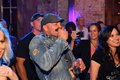 Randy Couture plays harmonic from audience.jpg