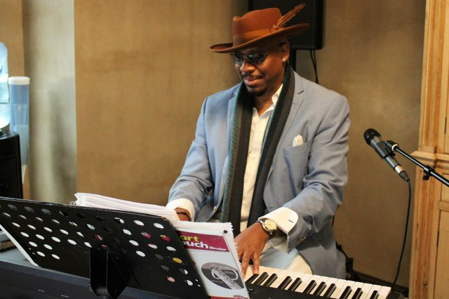 Jazz musician Karlton Taylor entertained guests.JPG