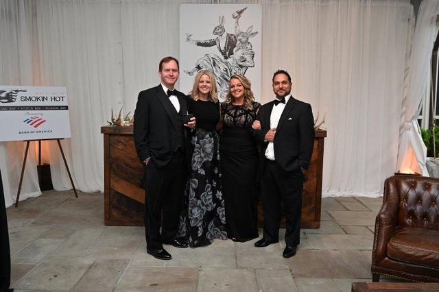 Smokin Hot Cigar Lounge sponsor Steven Mason of Bank of America, Amy-Beth Mason, Jessica and Faiz Niazi.JPG