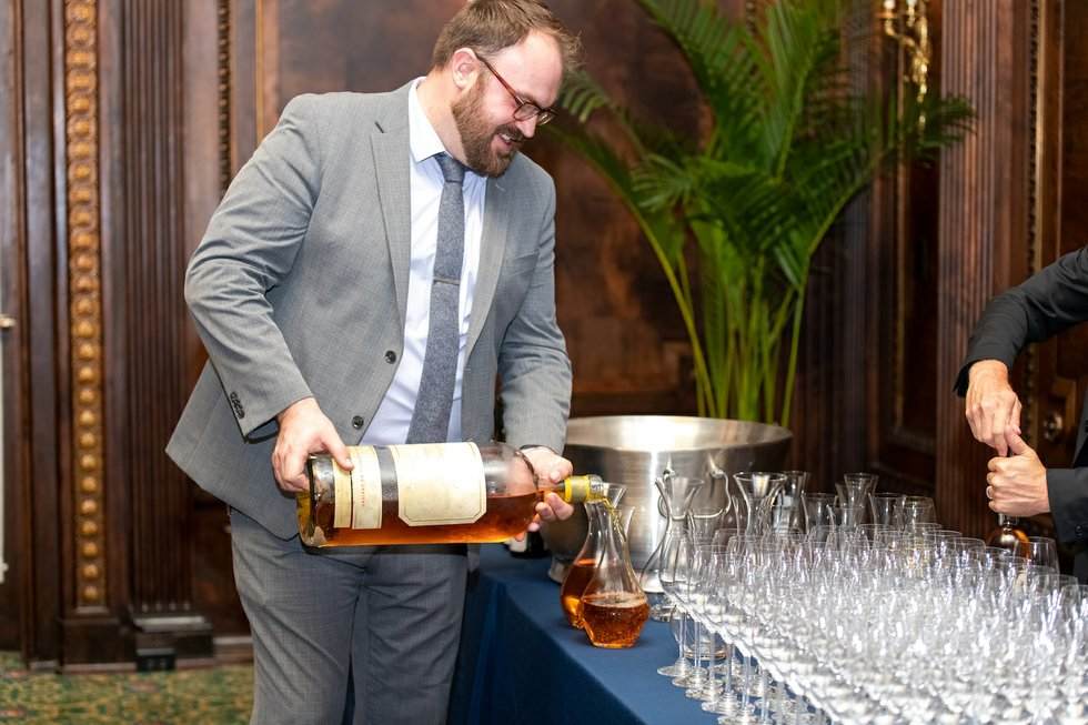 Dan Hutchinson pours wine.jpg