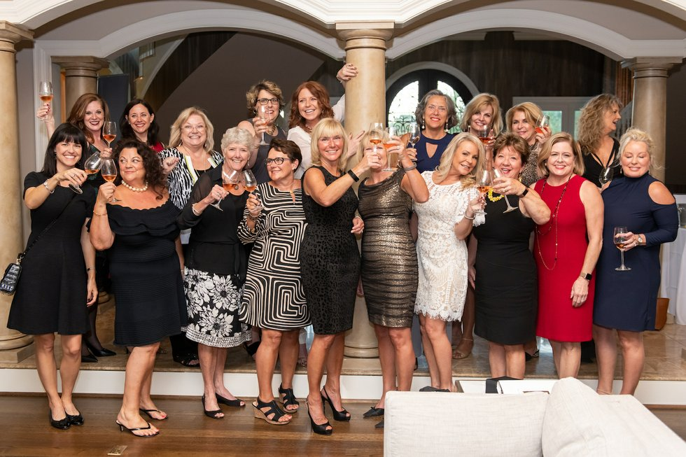 Cheers - group shot of women at Champagne and Chardonay.jpg
