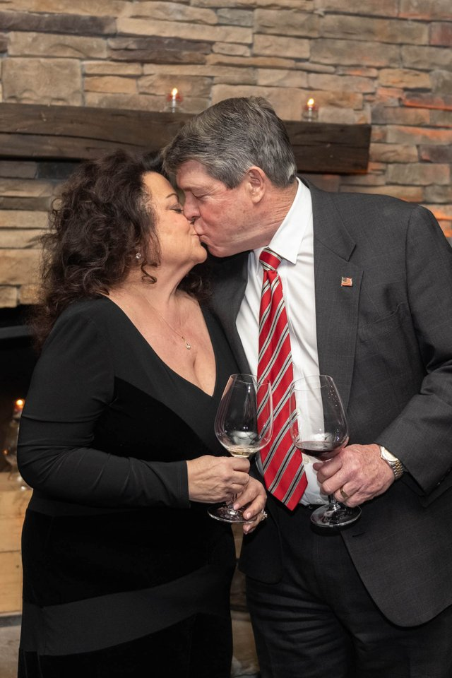 Sharon and Bill Piper kissing at Nashville Wine Auction Pairings Dinner.jpg