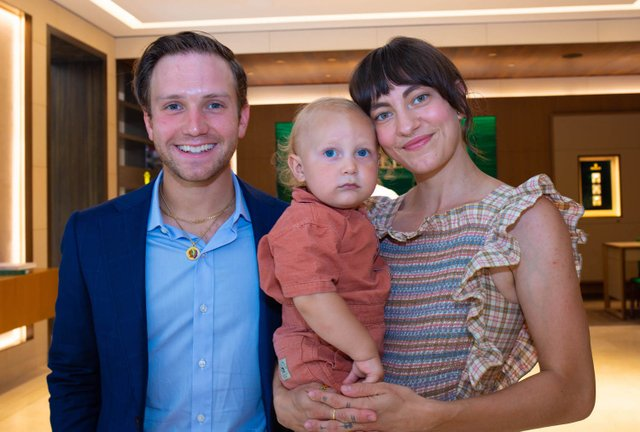 Alex and Taylor Johnson with son Levi.jpg